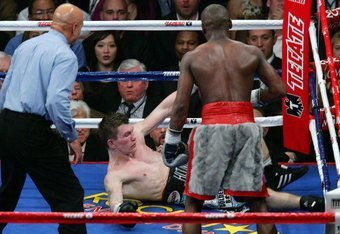 LAS VEGAS - DECEMBER 08:  Ricky Hatton is knocked down in the 10th round by Floyd Mayweather Jr. as referee Joe Cortez (L) moves in during their WBC world welterweight championship fight at the MGM Grand Garden Arena on December 8, 2007 in Las Vegas, Neva