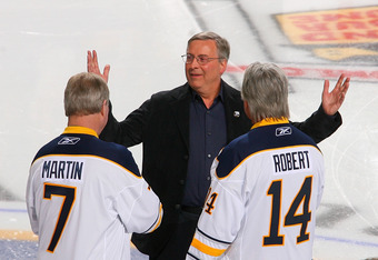 BUFFALO, NY - FEBRUARY 23:  New Buffalo Sabres owner Terry Pegula reacts as  former Sabres palyers Rene Robert #14 and  Rick Martin #7 skate out to meet him  during pre game ceremonies prior to play against the Atlanta Thrashers at HSBC Arena on February