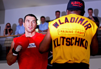 HAMBURG, GERMANY - JUNE 29:  Wladimir Klitschko during a public training day to preview his heavy weight title fight with David Haye at a Mercedes Benz showroom on June 29, 2011 in Hamburg, Germany.  (Photo by Scott Heavey/Getty Images)