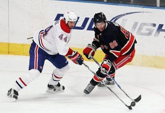NEW YORK, NY - JANUARY 11:  Roman Hamrlik #44 of the Montreal Canadiens pokes the away from Wojtek Wolski #86 of the New York Rangers on January 11, 2011 at Madison Square Garden in New York City.  (Photo by Jim McIsaac/Getty Images)
