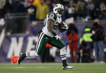 Shonn Greene scoring a touchdown against the Patriots in the 2011 playoffs.