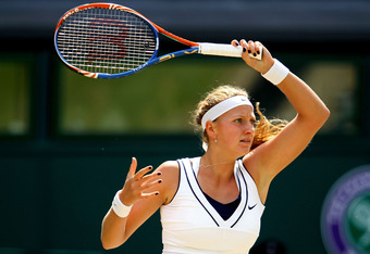 LONDON, ENGLAND - JULY 02:  Petra Kvitova of the Czech Republic in action during her Ladies' final round match against Maria Sharapova of Russia on Day Twelve of the Wimbledon Lawn Tennis Championships at the All England Lawn Tennis and Croquet Club on Ju