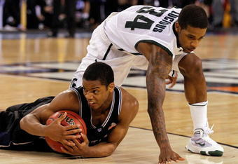 INDIANAPOLIS - APRIL 03:  Ronald Nored #5 of the Butler Bulldogs with the ball on the ground in front of Korie Lucious #34 of the Michigan State Spartans during the National Semifinal game of the 2010 NCAA Division I Men's Basketball Championship on April