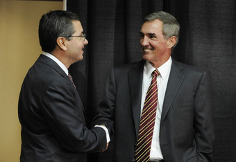 ASHBURN,VA - JANUARY 6:  Mike Shanahan, the new Executive Vice President and head coach of the Washington Redskins and owner Dan Snyder (L) shake hands before a press conference welcoming Shanahan to the Redskins on January 6, 2010 at Redskins Park in Ash