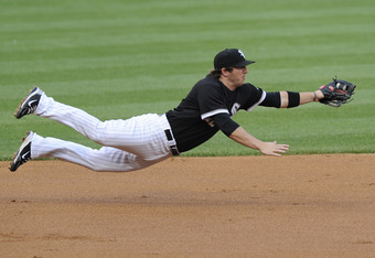 CHICAGO, IL - JUNE 03: Brent Morel #26 of the Chicago White Sox makes a diving catch in the first inning against the Detroit Tigers on June 3, 2011 at U.S. Cellular Field in Chicago, Illinois.  (Photo by David Banks/Getty Images)