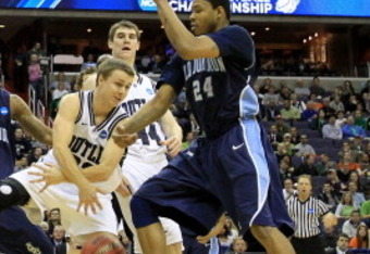 WASHINGTON - MARCH 17:  Grant Leiendecker #22 of the Butler Bulldogs dribbles past Kent Bazemore #24 of the Old Dominion Monarchs during the second round of the 2011 NCAA men's basketball tournament at the Verizon Center on March 17, 2011 in Washington, D