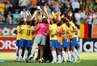 FRANKFURT AM MAIN, GERMANY - JULY 06:  The team of Brazil celebrates after winning the FIFA Women's World Cup 2011 Group D match between Equatorial Guinea and Brazil at FIFA World Cup stadium Frankfurt on July 6, 2011 in Frankfurt am Main, Germany.  (Phot