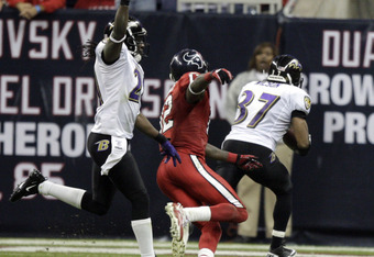 HOUSTON, TX - DECEMBER 13:  Cornerback Josh Wilson #37 of the Baltimore Ravens intercepts Matt Schaub of the Houston Texans for the winning touchdown in overtime as Derrick Ward #32 of the Houston Texans watches at Reliant Stadium on December 13, 2010 in