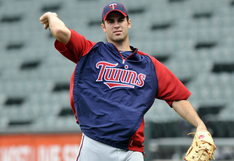 CHICAGO, IL - JULY 07:  Joe Mauer # 7 of the Minnesota Twins warms up before the game against the Chicago White Sox on July 7, 2011 at U.S. Cellular Field in Chicago, Illinois.  (Photo by David Banks/Getty Images)