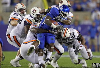 LEXINGTON, KY - OCTOBER 09: Raymond Sanders #4 of the Kentucky Wildcats is tackled by the Auburn Tigers defense during the SEC game at Commonwealth Stadium on October 9, 2010 in Lexington, Kentucky.  (Photo by Andy Lyons/Getty Images)