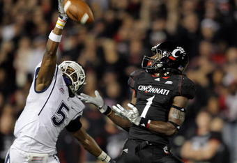 CINCINNATI - NOVEMBER 07:  Mardy Gilyard #1 of the Cincinnati Bearcats prepares to catch a pass while defended by Blidi Wreh-Wilson #5 of the Connecticut Huskies during the Big East Conference game at Nippert Stadium on November 7, 2009 in Cincinnati, Ohi