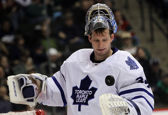 ST PAUL, MN - MARCH 22: James Reimer #34 of the Toronto Maple Leafs handles the puck during a time out against the Minnesota Wild at the Xcel Energy Center on March 22, 2011 in St Paul, Minnesota.  (Photo by Bruce Bennett/Getty Images)