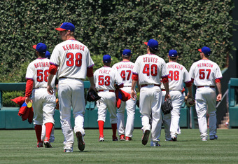 PHILADELPHIA - JULY 10: The Philadelphia Phillies relief pitchers walk out to the bullpen before a game against the Atlanta Braves at Citizens Bank Park on July 10, 2011 in Philadelphia, Pennsylvania. The Phillies won 14-1. (Photo by Hunter Martin/Getty I