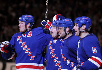 NEW YORK, NY - APRIL 20:  (L-R) Marc Staal #18, Brandon Dubinsky #17, Marian Gaborik #10 and Dan Girardi #5 of the New York Rangers celebrate after Dubinsky scored a goal in the second period against the Washington Capitals in Game Four of the Eastern Con