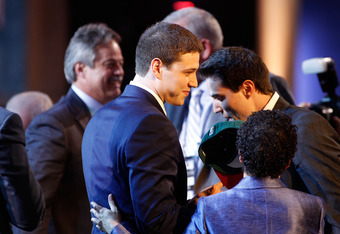 NEWARK, NJ - JUNE 23:  Jimmer Fredette from BYU celebrates with his guests in the green room after he was selected #10 overall by the Milwaukee Bucks in the first round during the 2011 NBA Draft at the Prudential Center on June 23, 2011 in Newark, New Jer
