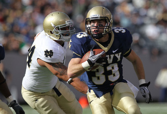 EAST RUTHERFORD, NJ - OCTOBER 23: John Howell #33 of the Navy Midshipmen rushes against the Notre Dame Fighting Irish at New Meadowlands Stadium on October 23, 2010 in East Rutherford, New Jersey.  (Photo by Nick Laham/Getty Images)