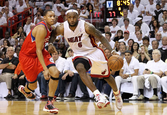 MIAMI, FL - APRIL 27:  LeBron James #6 of the Miami Heat drives by Evan Turner #12 of the Philadelphia 76ers during game five of the Eastern Conference Quarterfinals in the 2011 NBA Playoffs at American Airlines Arena on April 27, 2011 in Miami, Florida.