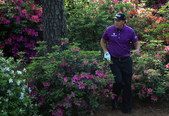 AUGUSTA, GA - APRIL 07:  Phil Mickelson looks over his second shot from the flowers on the 13th hole during the first round of the 2011 Masters Tournament at Augusta National Golf Club on April 7, 2011 in Augusta, Georgia.  (Photo by David Cannon/Getty Im