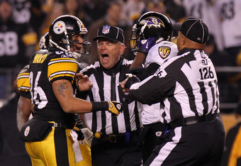 PITTSBURGH, PA - JANUARY 15:  Safety Ed Reed #20 of the Baltimore Ravens and wide receiver Hines Ward #86 of the Pittsburgh Steelers are separated by a referee after a play during the AFC Divisional Playoff Game at Heinz Field on January 15, 2011 in Pitts