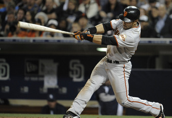 SAN DIEGO, CA - JULY 15: Andres Torres #56 of the San Francisco Giants hits an RBI single during the fifth inning of a baseball game against the San Diego Padres at Petco Park on July 15, 2011 in San Diego, California. The Giants won 6-1.   (Photo by Deni