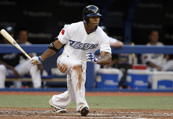 TORONTO, CANADA - JULY 15: Eric Thames #46 of the Toronto Blue Jays doubles for an RBI against the New York Yankees during MLB action at The Rogers Centre July 15, 2011 in Toronto, Ontario, Canada. (Photo by Abelimages/Getty Images)