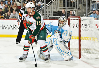 PITTSBURGH, PA - JANUARY 08:  Andrew Brunette #15 of the Minnesota Wild sets up in front of goaltender Marc-Andre Fleury #29 of the Pittsburgh Penguins on January 8, 2011 at CONSOL Energy Center in Pittsburgh, Pennsylvania.  (Photo by Jamie Sabau/Getty Im