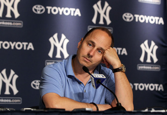 NEW YORK, NY - JULY 08:  General manager Brian Cashman of the New York Yankees speaks to the media after the game against the Tampa Bay Rays was postponed due to rain on July 8, 2011 at Yankee Stadium in the Bronx borough of New York City.  (Photo by Jim