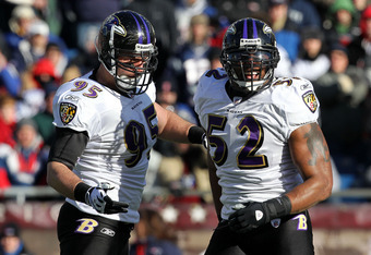 FOXBORO, MA - JANUARY 10:  (L-R) Jarrett Johnson #95 and Ray Lewis #52 of the Baltimore Ravens react after Lewis acked Tom Brady #12 of the New England Patriots during the first quarter pf the 2010 AFC wild-card playoff game at Gillette Stadium on January