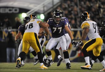 BALTIMORE - NOVEMBER 29:  Matt Birk #77 of the Baltimore Ravens defends against the Pittsburgh Steelers at M&T Bank Stadium on November 29, 2009 in Baltimore, Maryland. The Ravens defeated the Steelers 20-17. (Photo by Larry French/Getty Images)