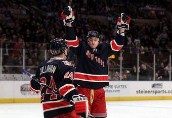 NEW YORK, NY - DECEMBER 12:  Brandon Dubinsky #17 of the New York Rangers celebrates his second period goal against the Washington Capitals with teammate Ryan Callahan #24 on December 12, 2010 at Madison Square Garden in New York City.  (Photo by Jim McIs