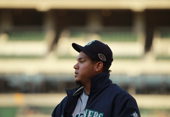 OAKLAND, CA - JULY 05:  Starting pitcher Felix Hernandez #34 of the Seattle Mariners walks to the dugout from the bullpen before their game against the Oakland Athletics at Oakland-Alameda County Coliseum on July 5, 2011 in Oakland, California.  (Photo by