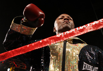 LAS VEGAS, NV - JULY 23:  Zab Judah puts his arm up as he enters the ring to take on Amir Khan in their super lightweight world championship unification bout at Mandalay Bay Events Center on July 23, 2011 in Las Vegas, Nevada.  (Photo by Scott Heavey/Gett