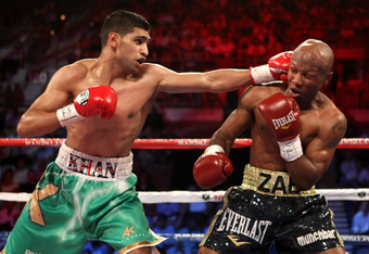 LAS VEGAS, NV - JULY 23:  (L-R) Amir Khan throws a left at Zab Judah in the first round during their super lightweight world championship unification bout at Mandalay Bay Events Center on July 23, 2011 in Las Vegas, Nevada.  (Photo by Scott Heavey/Getty I