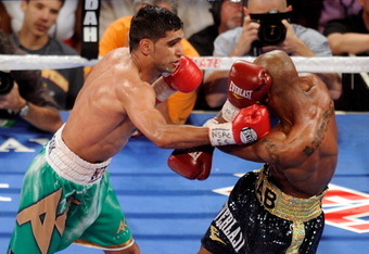 LAS VEGAS, NV - JULY 23:  (L-R) Amir Khan throws a right at Zab Judah during their super lightweight world championship unification bout at Mandalay Bay Events Center on July 23, 2011 in Las Vegas, Nevada.  (Photo by Ethan Miller/Getty Images)