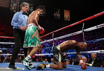 LAS VEGAS, NV - JULY 23:  (L-R) Amir Khan knocks out Zab Judah in the fifth round during their super lightweight world championship unification bout at Mandalay Bay Events Center on July 23, 2011 in Las Vegas, Nevada.  (Photo by Scott Heavey/Getty Images)