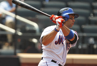 NEW YORK, NY - JULY 21:  Carlos Beltran #15 of the New York Mets flies out in the ninth inning against the St. Louis Cardinals during their game on July 21, 2011 at Citi Field in the Flushing neighborhood of the Queens borough of New York City.  (Photo by