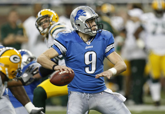 DETROIT , MI - NOVEMBER 26:  Matthew Stafford #9 of the Detroit Lions looks to throw a fourth quarter pass while playing the Green Bay Packers on November 26, 2009 at Ford Field in Detroit, Michigan. Green Bay won the game 34-12. (Photo by Gregory Shamus/
