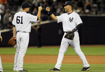NEW YORK, NY - JULY 25:  Steve Garrison #61 and Derek Jeter #2 of the New York Yankees celebrate after defeating the Seattle Mariners on July 25, 2011 at Yankee Stadium in the Bronx borough of New York City.  (Photo by Jim McIsaac/Getty Images)