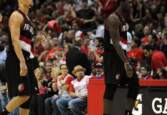 HOUSTON - APRIL 30:  Greg Oden #52, Brandon Roy #7 and Steve Blake #2 of the Portland Trail Blazers walk off the court during play against the Houston Rockets in Game Six of the Western Conference Quarterfinals during the 2009 NBA Playoffs at Toyota Cente