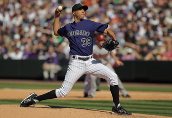 DENVER, CO - APRIL 01:  Starting pitcher Ubaldo Jimenez #38 of the Colorado Rockies delivers against the Arizona Diamondbacks during Opening Day at Coors Field on April 1, 2011 in Denver, Colorado.  (Photo by Doug Pensinger/Getty Images)