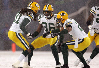 Green Bay Packers Al Harris, left, Nick Collins and Charles Woodson celebrate an interception during the first half of the NFL game on Monday Night Football November 27, 2006 at Qwest Field in Seattle, Washington. (Photo by Kevin Casey/NFLPhotoLibrary)