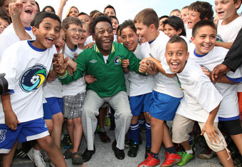 Pele celebrating with kids following the rebirth of the New York Cosmos