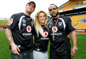 AUCKLAND, NEW ZEALAND - JUNE 11:  (L-R) WWE wrestlers CM Punk, Natalya and MVP pose for a photo with Warriors jerseys after a  Warriors NRL  training session at Mt Smart Stadium on June 11, 2008 in Auckland, New Zealand.  (Photo by Sandra Mu/Getty Images)