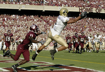 COLLEGE STATION, TX - SEPTEMBER 27:  Wide receiver Larry Fitzgerald #1 of the University of Pittsburgh Panthers pulls in a touchdown pass against the Texas A&M University Aggies at Kyle Field on September 27, 2003 in College Station, Texas. Pittsburgh def