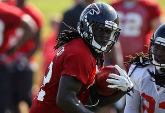 FLOWERY BRANCH, GA - JULY 30:  Jerious Norwood #32 of the Atlanta Falcons runs drills against Dunta Robinson #23 during opening day of training camp on July 30, 2010 at the Falcons Training Complex in Flowery Branch, Georgia.  (Photo by Kevin C. Cox/Getty