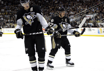 PITTSBURGH, PA - DECEMBER 28:  Evgeni Malkin #71 and Sidney Crosby #87 of the Pittsburgh Penguins line up for a face-off against the Atlanta Thrashers at Consol Energy Center on December 28, 2010 in Pittsburgh, Pennsylvania.  The Penguins defeated the Thr