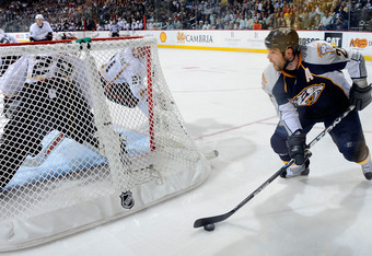 NASHVILLE, TN - APRIL 17:   Steve Sullivan #26 of the Nashville Predators carries the puck behind goalie Ray Emery #29 of the Anaheim Ducks in Game Three of the Western Conference Quarterfinals during the 2011 NHL Stanley Cup Playoffs at the Bridgestone A