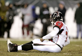 PHILADELPHIA - JANUARY 23:  Quarterback Michael Vick #7 of the Atlanta Falcons reacts after throwing an interception pass to Brian Dawkins #20 of the Philadelphia Eagles in the fourth quarter during the NFC Championship game at Lincoln Financial Field on
