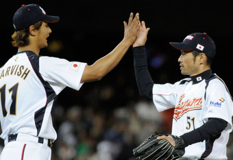 LOS ANGELES, CA - MARCH 22:  Pitcher Yu Darvish #11 and Ichiro Suzuki #51 of Japan celebrate after defeating the United States to win the semifinal game of the 2009 World Baseball Classic on March 22, 2009 at Dodger Stadium in Los Angeles, California. Jap