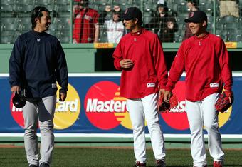 BOSTON - APRIL 20:  Hideki Okajima #37 and Daisuke Matsuzaka #18 of the Boston Red Sox talk with Kei Igawa #29 of the New York Yankees on April 20, 2007 at Fenway Park in Boston, Massachusetts.  (Photo by Elsa/Getty Images)